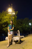 Thai Woman Relax in Park at night near river Royalty Free Stock Images