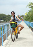 Thai woman riding a bike Stock Photography