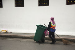 Thai woman road sweeper cleaning working keep garbage and push g. Arbage cart at the road on July 7, 2016 in Bangkok, Thailand Royalty Free Stock Photography