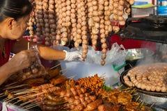 Thai woman sell meatballs Stock Image