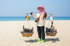 Thai woman selling souvenirs at beach in Phuket Royalty Free Stock Photo