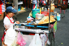 Thai woman sells food, Bangkok, Thailand. Royalty Free Stock Photography