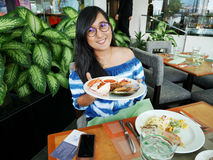Thai woman show cuisine on plate before eat royalty free stock photography