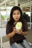 Thai woman show melon ice cream before eating at Cafe. And restaurant in Thailand royalty free stock photography