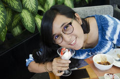 Thai woman show sweet dessert before eat in restaurant of Hotel. Thai woman show sweet dessert before eat at food buffet service in restaurant of Hotel in Stock Image