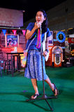 Thai woman singing folk song on stage Stock Image