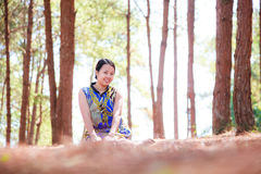 Thai woman sit and smile in park Stock Images