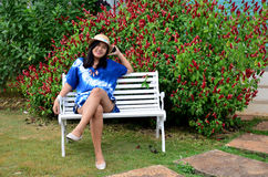 Thai woman sitting on the bench Royalty Free Stock Photography