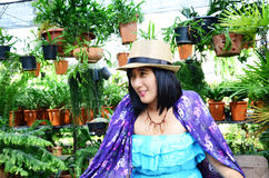 Thai woman sitting in the garden Stock Images
