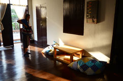 Thai woman stand at Homestay with Light of sunset time in Chiang Rai, Thailand. Stock Image