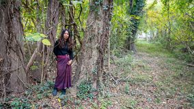 Thai woman in sarang standing in forest in fall stock images
