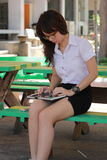 Thai woman student university beautiful girl using her tablet. Royalty Free Stock Photo