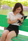 Thai woman student university beautiful girl using her tablet. Stock Photography