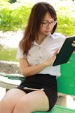 Thai woman student university beautiful girl using her tablet. Royalty Free Stock Images