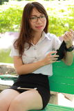 Thai woman student university beautiful girl using her tablet. Royalty Free Stock Photography