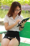Thai woman student university beautiful girl using her tablet. Stock Photos