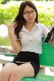 Thai woman student university beautiful girl using her tablet. Stock Photo