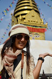 Thai woman in Swayambhunath Temple or Monkey Temple Royalty Free Stock Image