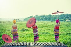 Thai Woman In Traditional Costume with umbrella thai culture st. Yle on oudoor. Thailand stock photo