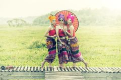 Thai Woman In Traditional Costume with umbrella thai culture st royalty free stock photo