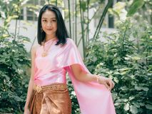 Thai woman in traditional Thai costume of ordinary ancient lady. Thai woman in traditional Thai costume of ordinary Thai ancient lady in the garden royalty free stock photography