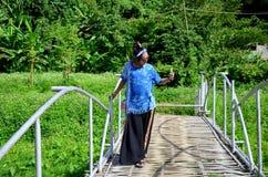 Thai woman use smart phone take photo view of Baan Natong villag Stock Photos