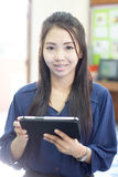 Thai woman using tablet Royalty Free Stock Photography