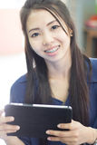 Thai woman using tablet Royalty Free Stock Photo