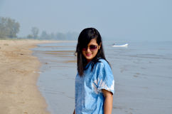 Thai woman walking and portrait at Chaiya Beach Royalty Free Stock Photography