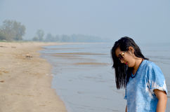 Thai woman walking and portrait at Chaiya Beach Stock Photos