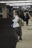 Thai woman walking to gate inside at Narita International Airpor Stock Image