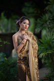 Thai woman wearing typical Thai dress Stock Photo