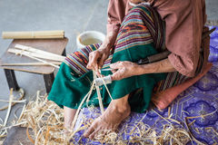 Thai woman working on bamboo using for umbrella Stock Photos