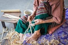 Thai woman working on bamboo using for umbrella Stock Photos