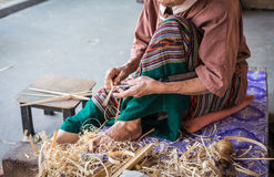 Thai woman working on bamboo using for umbrella Stock Photography