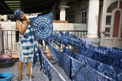 Thai women working Indigenous knowledge of thailand tie batik dyeing indigo color at outdoor on top of house at Thailand. Thai woman working Indigenous knowledge stock photography
