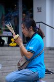 Thai woman worships and prays at outdoor shrine Bangkok Thailand Stock Images