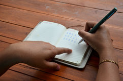 Thai woman write note book Stock Images