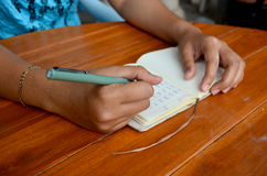 Thai woman write note book Stock Photos
