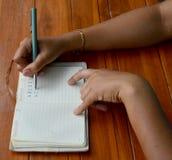 Thai woman write note book Royalty Free Stock Photo