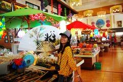 Thai women holding paper fan with Handmade Art Umbrella at Bo-sa Stock Photos
