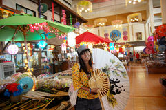 Thai women holding paper fan with Handmade Art Umbrella at Bo-sa Royalty Free Stock Photo