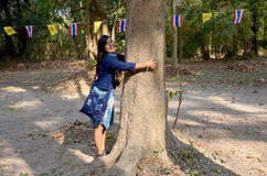 Thai women love and hug tree in garden at Donsawan island Royalty Free Stock Photo