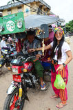 Thai women pay carfare to driver of tricycle. On July 13, 2014 in Bago, Burma. Hanthawaddy, as it was constituted in 1911, consisted of a vast plain stretching stock photos