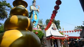 Thai women people praying beautiful chinese goddess Guan Yin bodhisattva statue stock video footage