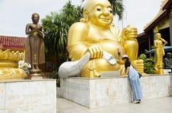 Thai women people visit and respect praying Wat Sakae Krang at Uthai Thani, Thailand. Thai women people visit and respect praying Katyayana or Gautama Buddha Stock Photography