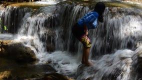 Thai women playing Kroeng Krawia Waterfall stock video
