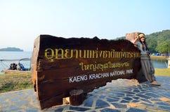 Thai Women portrait with Billboard of  Kaeng Krachan National Park Royalty Free Stock Image