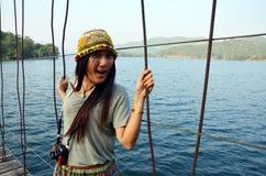 Thai Women portrait on the bridge at location Kaeng Krachan Dam Stock Photos