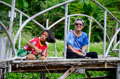 Thai women portrait with children fishing on Bamboo bridge at Ba Stock Photography